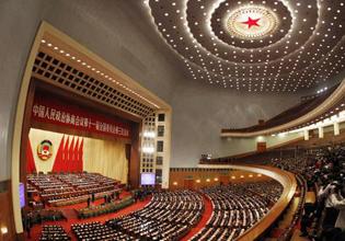 全国政协十一届三次会议在国歌声中闭幕