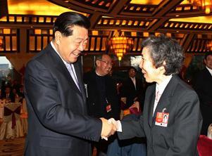 全国政协办公厅中央统战部举行招待会 贾庆林出席