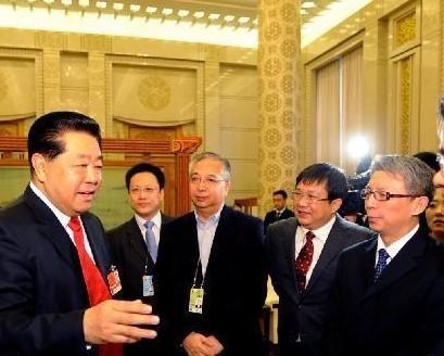 贾庆林会见两会报道新闻单位负责同志