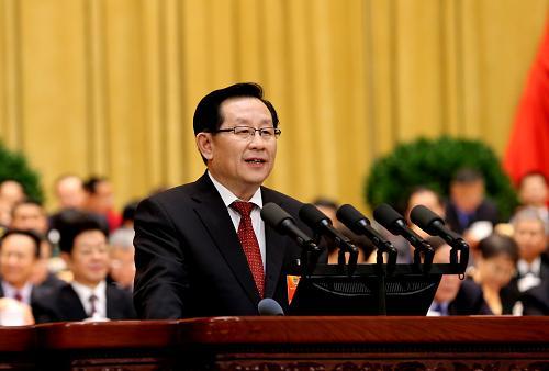 3月3日,中国人民政治协商会议第十二届全国委员会第一次会议在北京人民大会堂开幕。这是万钢受政协第十一届全国委员会常务委员会委托,向大会作关于提案工作情况的报告。新华社记者 刘卫兵 摄